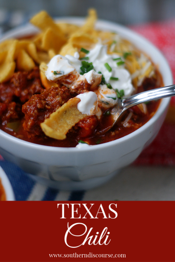 Texas Chili is an easy recipe made with a flavorful blend of spices and beef with no beans. Harkening back to the chuck wagon days, Texas Chili warms the heart and soul on crisp days.  Delicious with corn chips, cheese and sour cream. #Texas #chili #nobeans #fritos #southerndiscourse