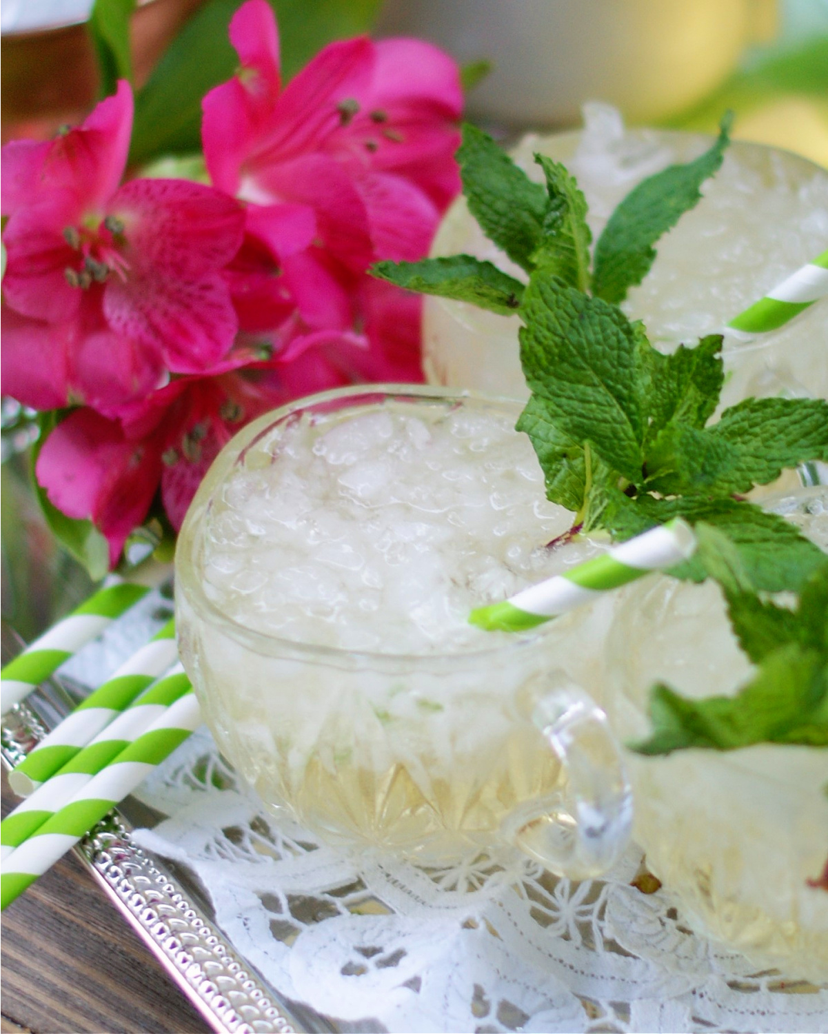 Champagne Julep Punch with mint garnish and striped straw for a derby party.