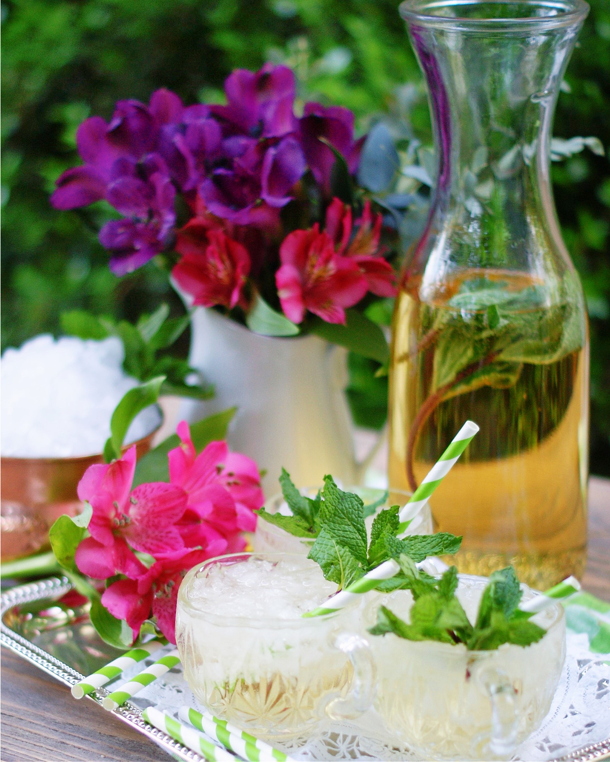 Champagne Julep Punch with mint, vanilla, ginger ale and fruit juices.
