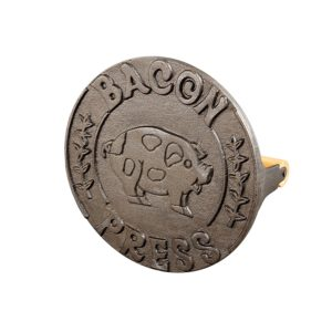 An affiliate link for a round cast iron bacon press for cooking bacon.
