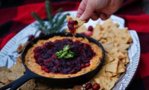 Served straight from the skillet, all warm and melty with a little kick and topped with those wonderfully red Christmas-time cranberries, Southern Cranberry & Cheddar Skillet Dip is a gorgeously easy must-have for your next holiday gathering.