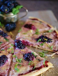 This blackberry mint pizza with subtly sweet marscapone cheese, plump blackberries, and blackberry jam is perfect for brunch, a savory dessert, coffee or tea time. A gorgeous mix of bread, cheese, fruit, and herbs, this pizza has all the ingredients of a romantic picnic without the picnic basket!