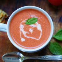 thick and creamy tomato basil soup with extra cream