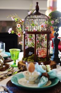 Wide view of woodland Easter tablescape centerpiece and place setting.