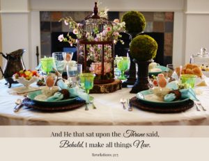 Woodland Easter Tablescape title image shows 4 place settings with chargers, dinner, bread plate, and teacup stacked. Pink floral centerpiece in birdcage with 2 moss covered balls on candlesticks.
