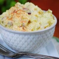 Deviled egg potato salad texture, ingredients and garnish of papriks