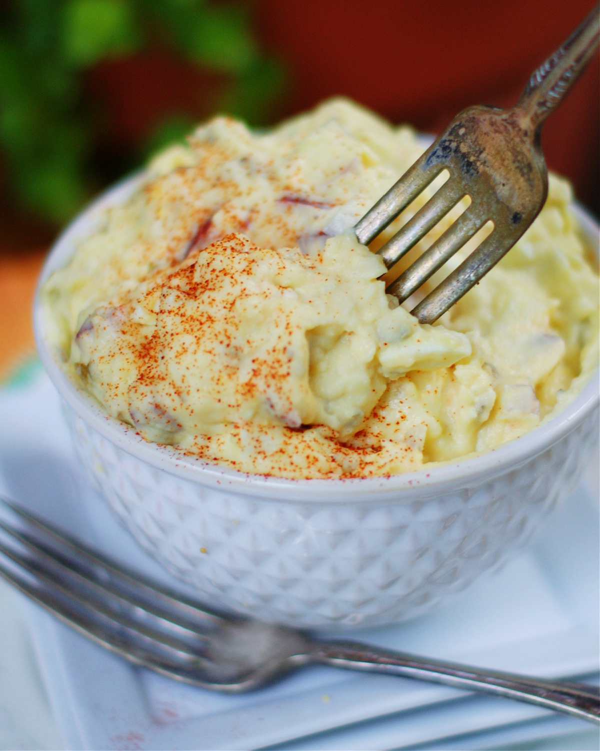 Deviled Egg Potato Salad on a fork to provide anothe close up view.
