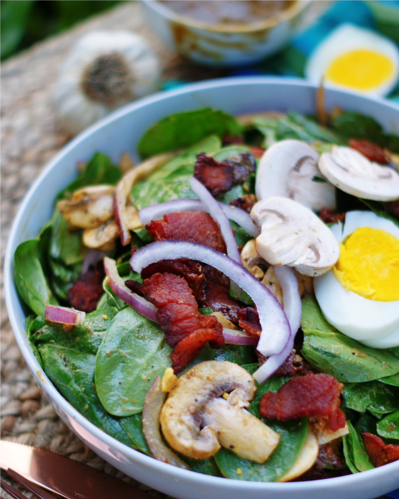 Hot bacon dressing tossed over a spinach salad