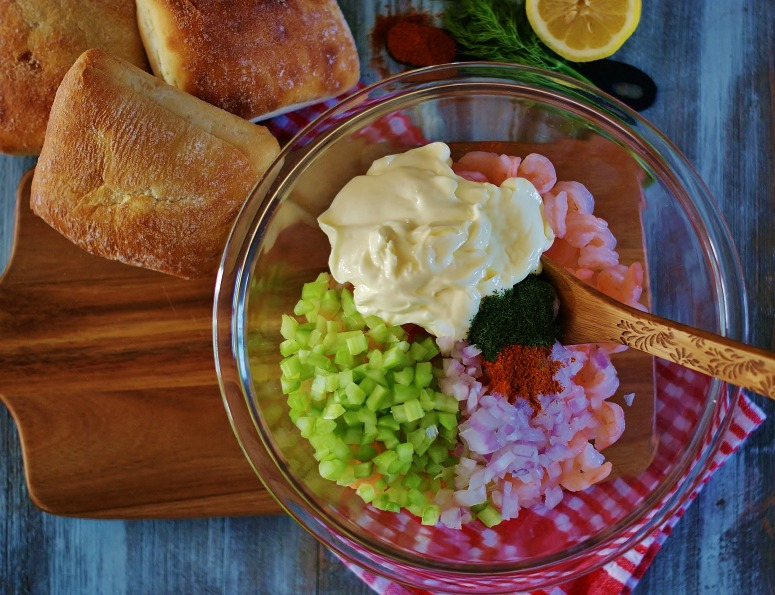 The ingredients for a shrimp salad roll in a bowl to be mixed.
