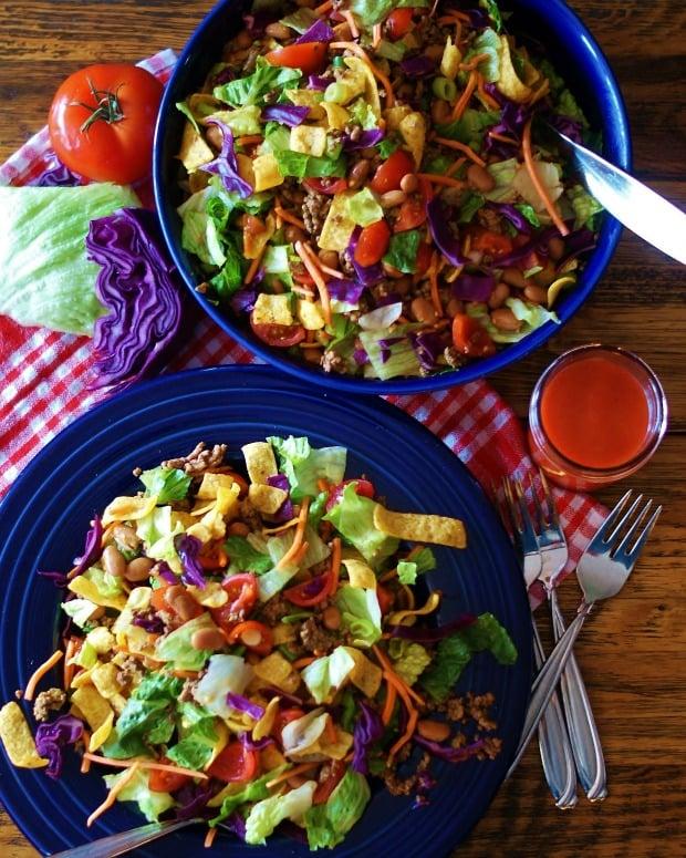 Two blue bowls full of Catalina Taco Salad
