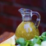 Melon Salad dressing in a glass bottle.
