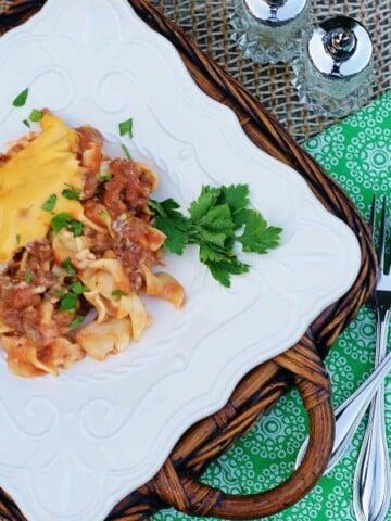 Cheesy Beef Noodle Casserole with creamy mushroom tomato sauce