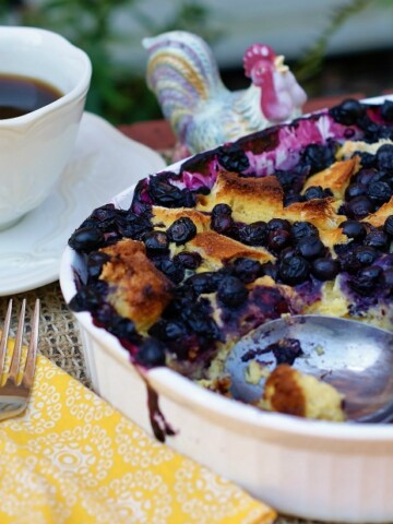An easy make ahead breakfast casserole with blueberries, sourdough bread and eggs.
