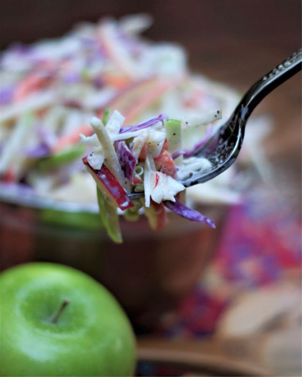 forkful of apple coleslaw with homemade buttermilk dressing.