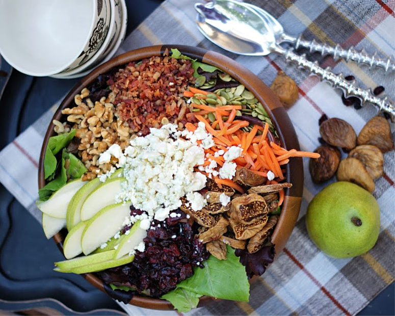 Autumn Pear Salad ingredients layered in a bowl.