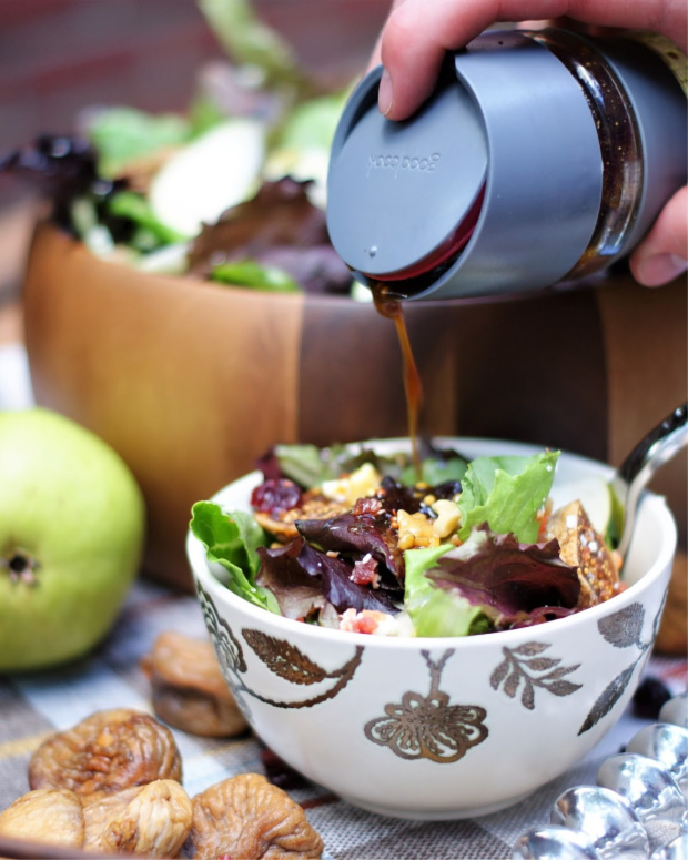 Pouring the molasses vinaigrette on an autumn pear salad with figs.