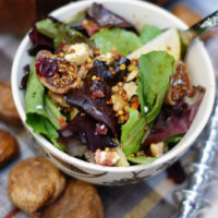 An autumn pear salad with figs dressed with a molasses vinaigrette