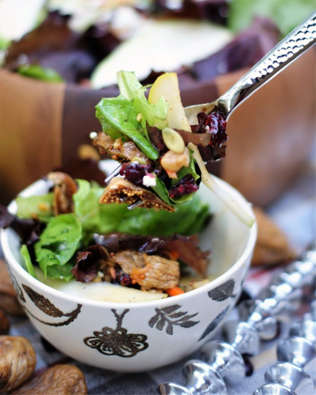 A forkful bite of autumn pear salad with figs and molasses vinaigrette