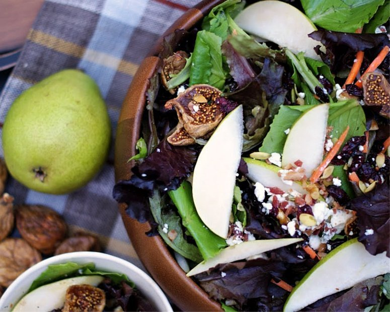 Autumn pear salad in a wooden bowl.