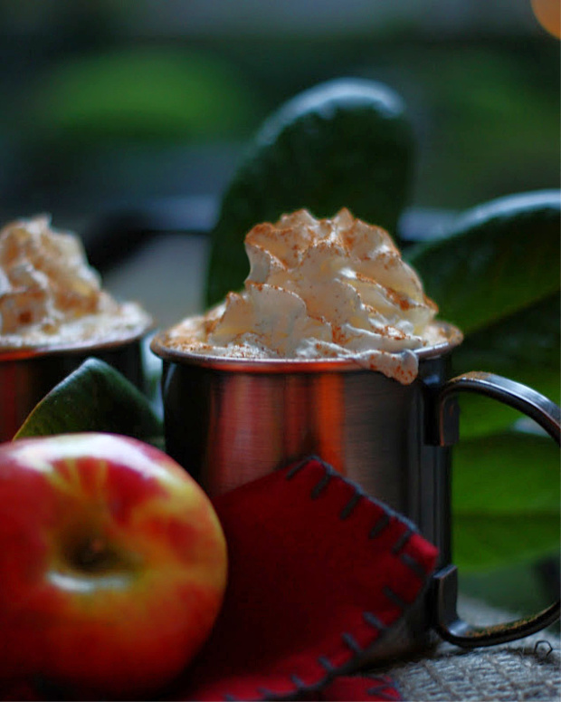 a copper mug of caramel apple cider.