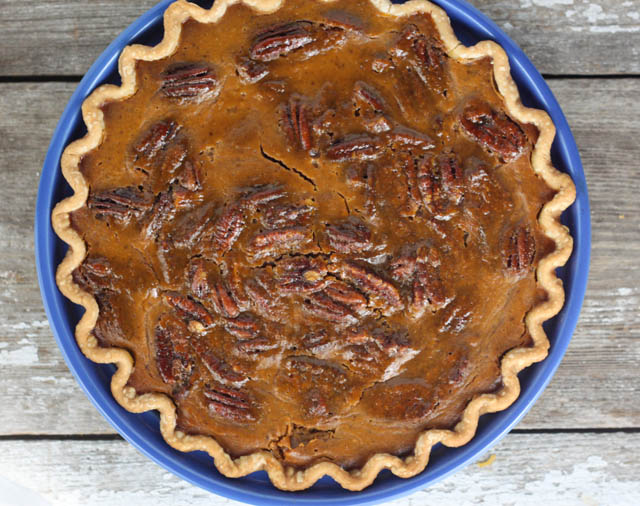 Pumpkin pecan pie marries 2 traditional Thanksgiving desserts.