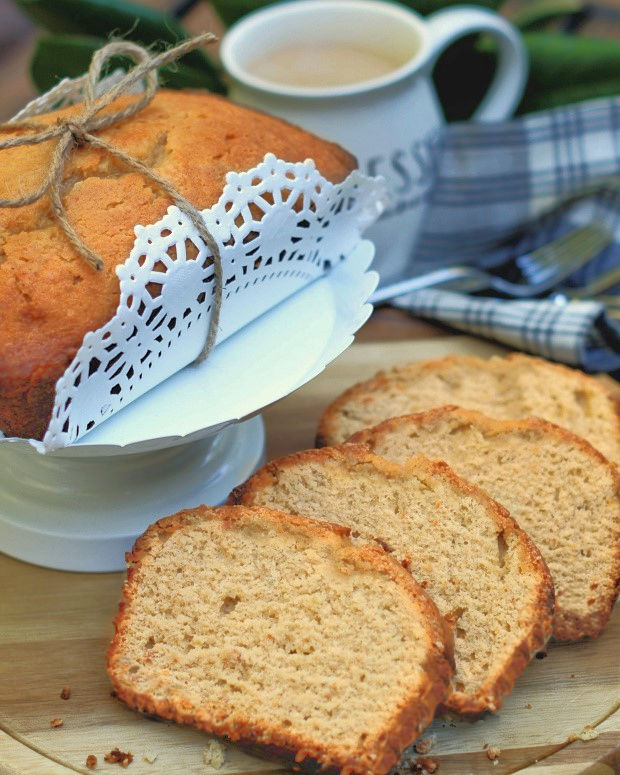 Slices of sweet potato pound cake next to a loaf packaged up to share