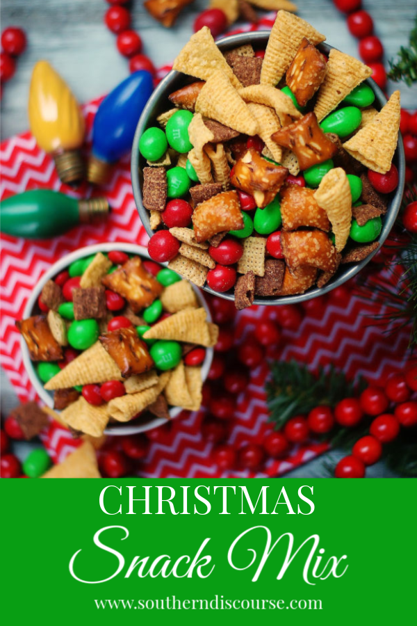 Salty, crunchy and just sweet enough, I can't think of a single thing you might do this holiday season where this Peanut Butter and Chocolate Christmas Snack Mix won't be a hit.  #snackmix #pretzels #chexmix #southerndiscourse