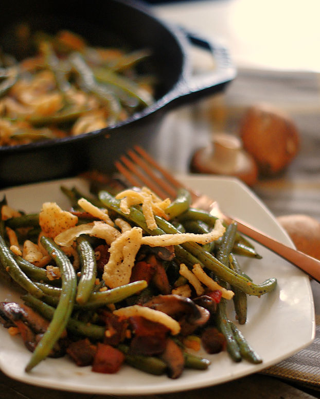 Sauteed Green beans served on a white plate.