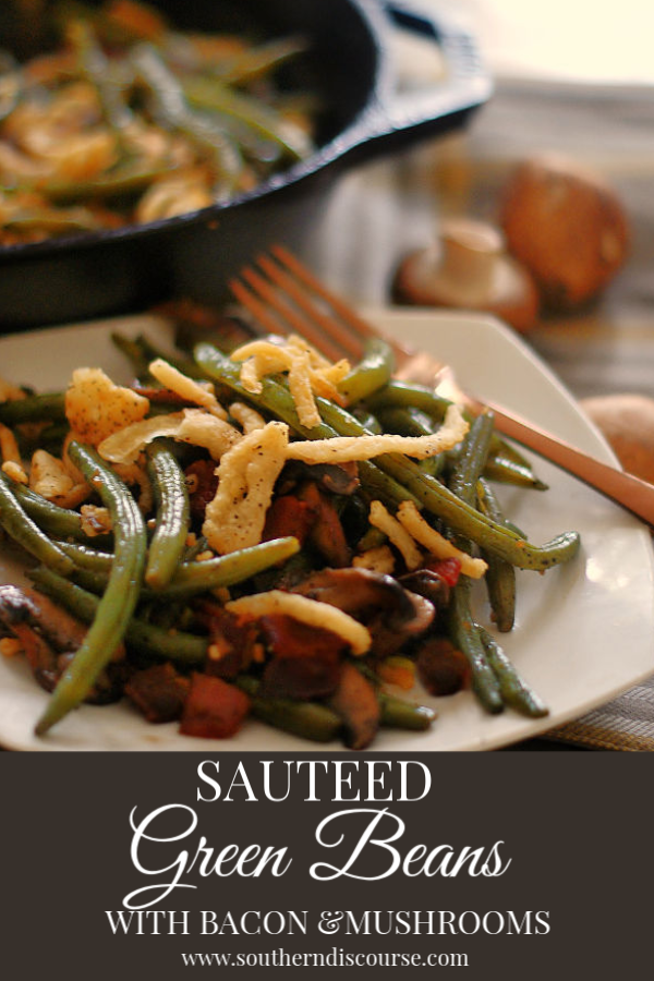 Sautéed with bacon and baby portobellas, these green beans are bursting with rich, earthy favors that you just won't believe! Love green bean casserole, but don't love all that goes in it? Well, this is your recipe too! #sidedish #veggies #southerndiscourse