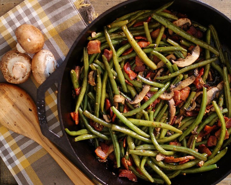 The green beans tossed with bacon and mushrooms.