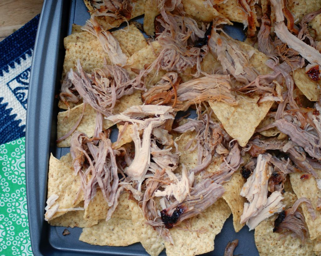 The base layer of chips and pulled pork.