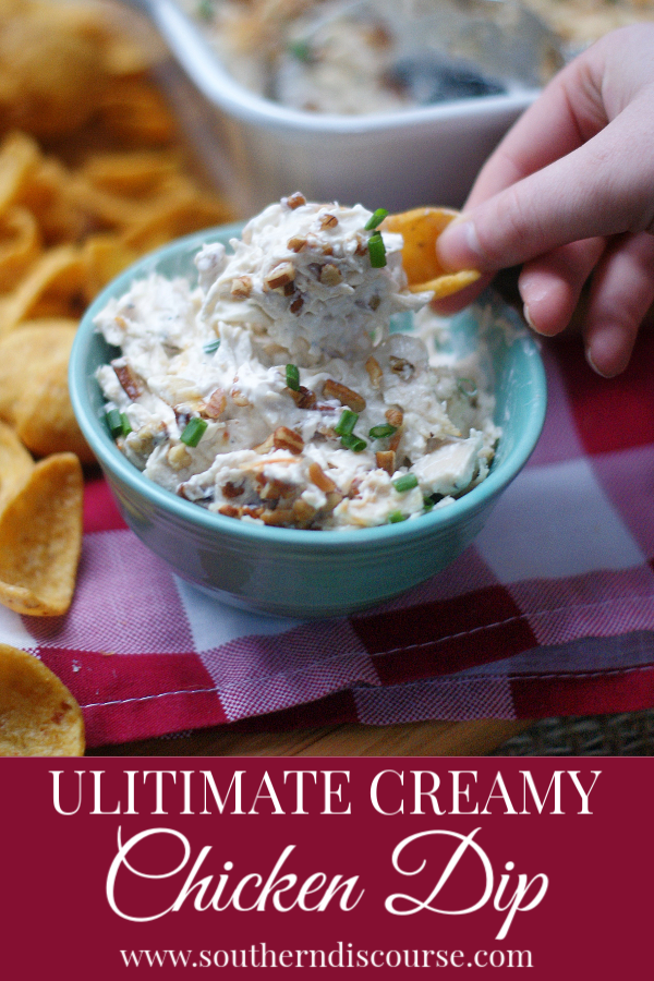 Shredded chicken, cream cheese, Parmesan, pecans and spices come together to make a deliciously addictive dip that's served hot!  Perfect appetizer for game day, parties, showers.   #gamedayfood #southerndiscourse #hotdip #chickendip #chipsanddip