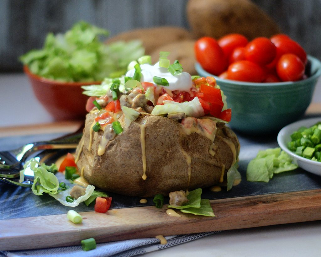 Loaded Baked Potato with tomatoes, lettuce, sour cream and queso.