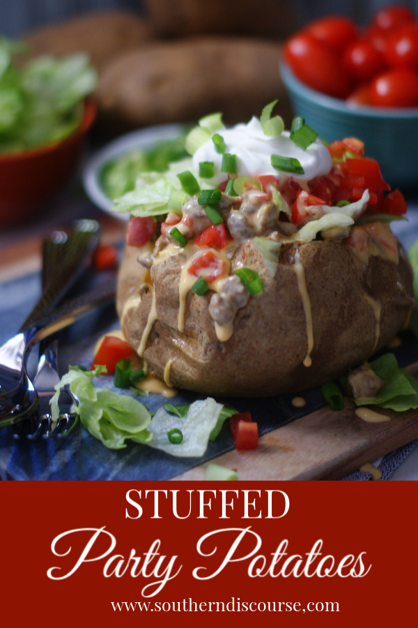 Stuffed Party Potatoes are baked then piled high with spicy sausage queso, lettuce, tomatoes, sour cream and green onions.  Perfect for game days, getting together with friends and baked potato bars!  #southerndiscourse #stuffedpotatoes #queso #gamedayfood