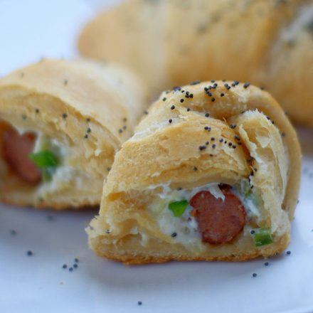 Upclose of cut open Hawaiian Popper Crescent Roll