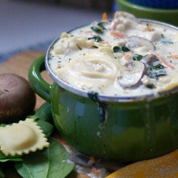 A full bowl of ravioli soup.