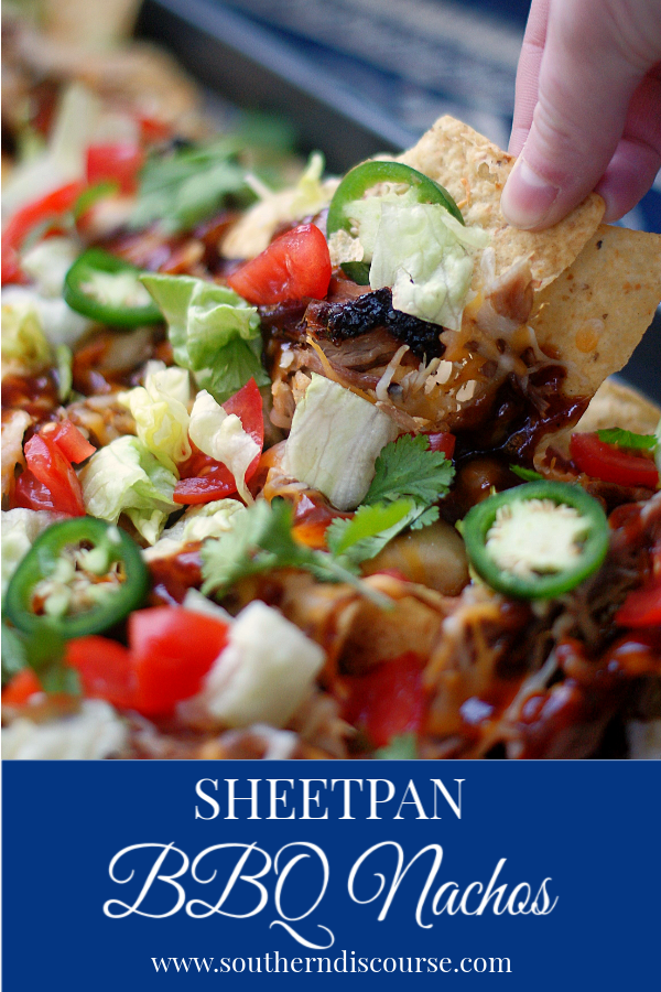 Smoky Pulled Pork, Cheddar cheese, BBQ sauce, and all the toppings make these Sheet Pan BBQ Nachos a win for parties, game nights and weekends! #nachos #sheetpan #superbowl #BBQ