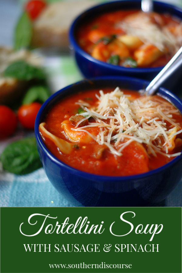 Italian Tortellini Soup with Sausage and Spinach is made in a easy, rich tomato soup base and topped with parmesan cheese.  Made with cheese tortellini this is a simple comfort soup that everyone will love!  #tortellini #italian #soup #southerndiscourse #comfortfood #tomatosoup