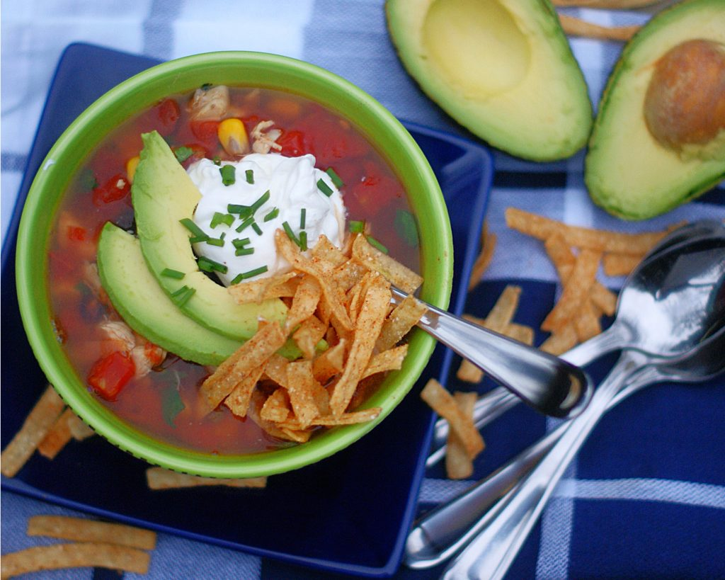 Chicken Tortilla Soup served with avocado