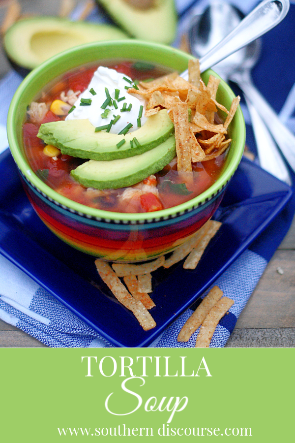 Easy homemade Chicken Tortilla Soup is a quick and easy meal!  With shredded chicken, black beans, corn, avocados, canned diced tomatoes & chiles and a splash of lime, this is a warm and yummy Tex-Mex dish at home without a lot of time and mess! #texmex #chicken #tortillasoup #soup #southerndiscourse