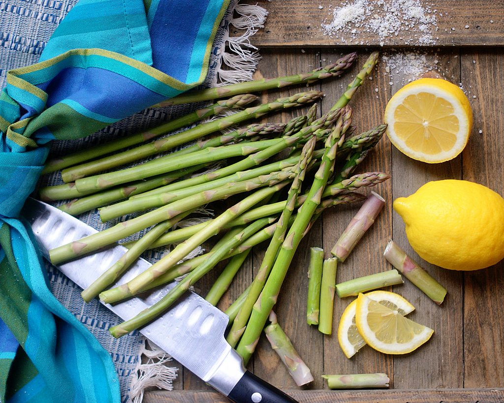 Asparagus being trimmed for cooking.