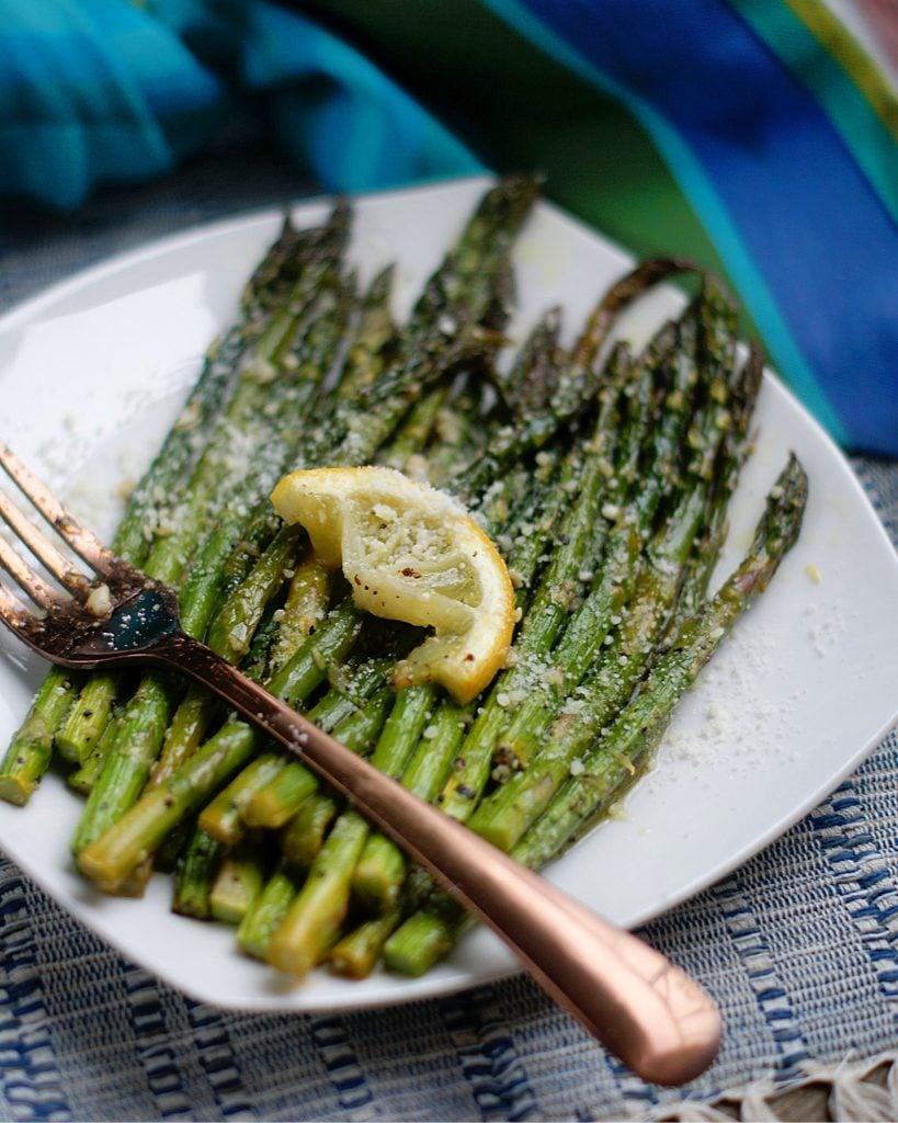 Lemon Roasted Asparagus on a white plate.