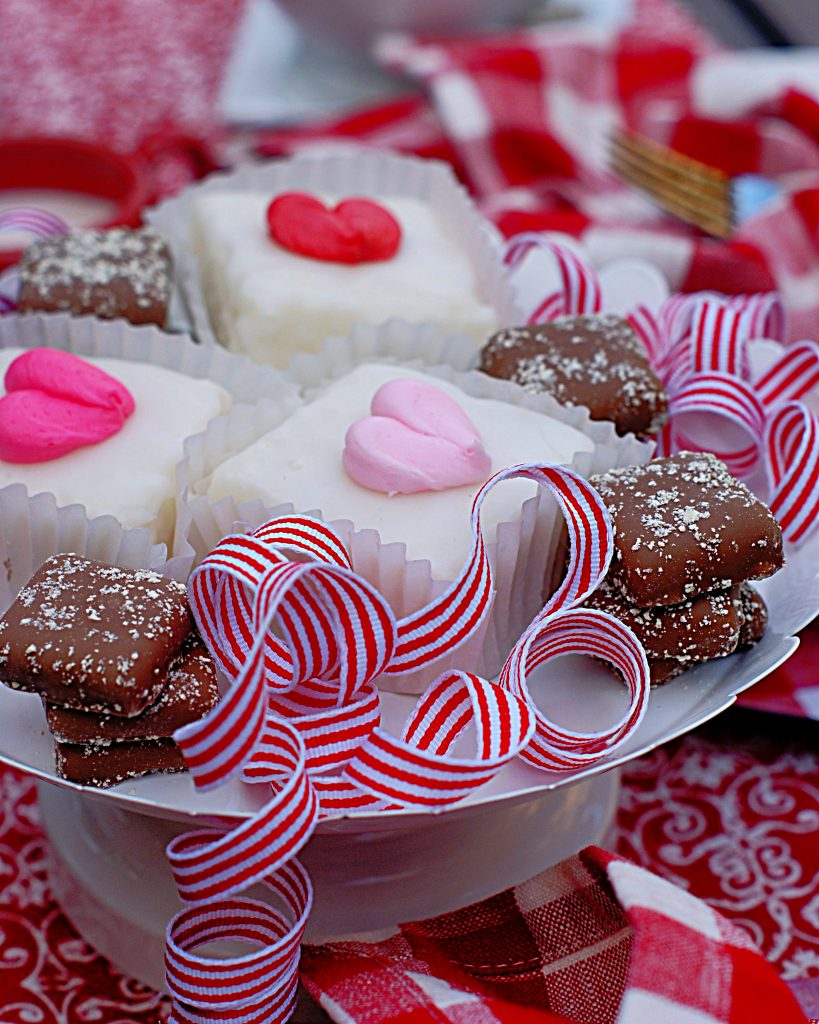 A pedestal full of sweet cakes for Valentine's Day.