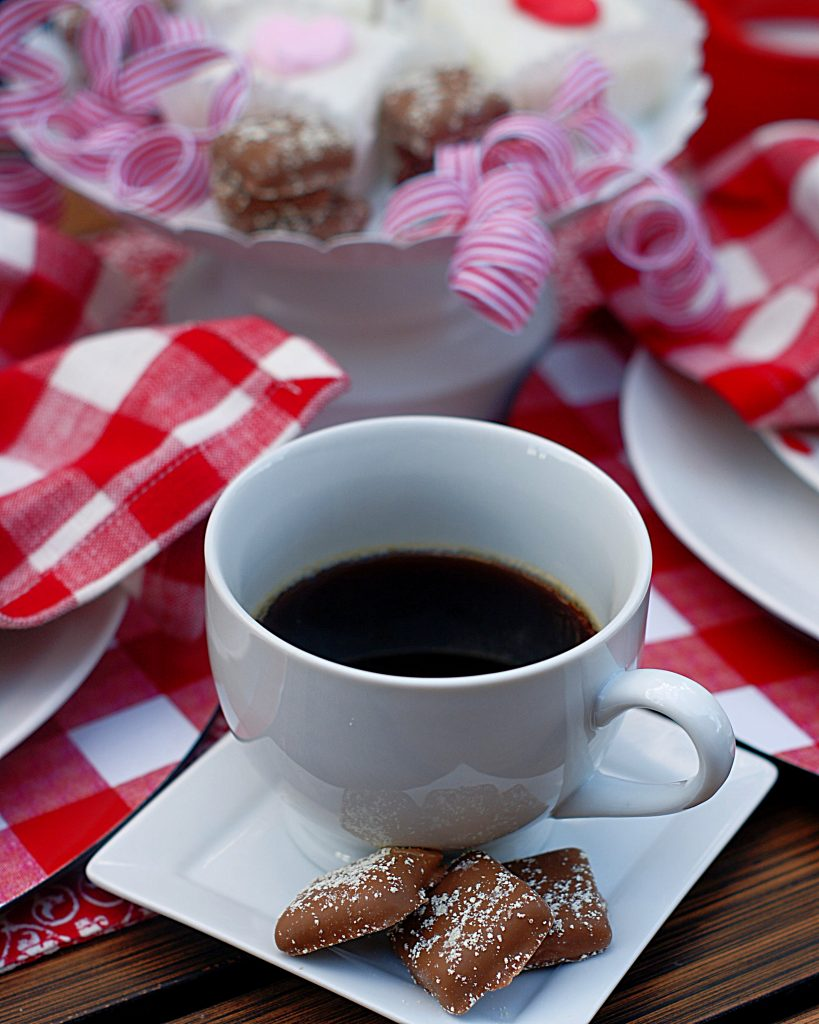 Cup of coffee with Valentine chocolates.