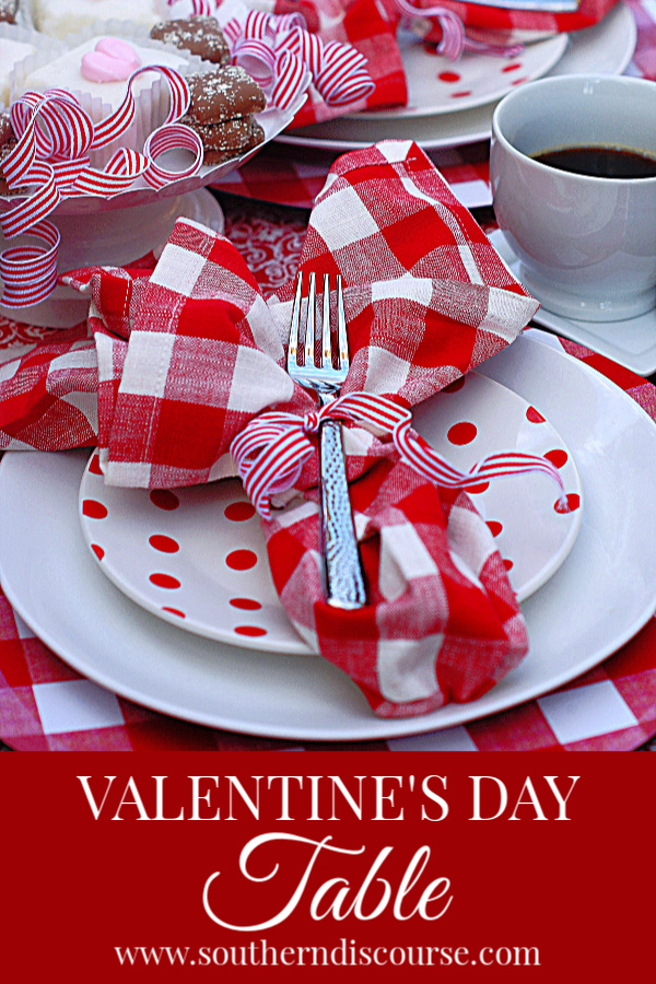 A casual Valentine table for coffee and dessert.  Red gingham, polka dots and stripes keep this table easy, fun and romantic.  #valentine #valentinesday #coffee #desserttable #dessert #southerndiscourse
