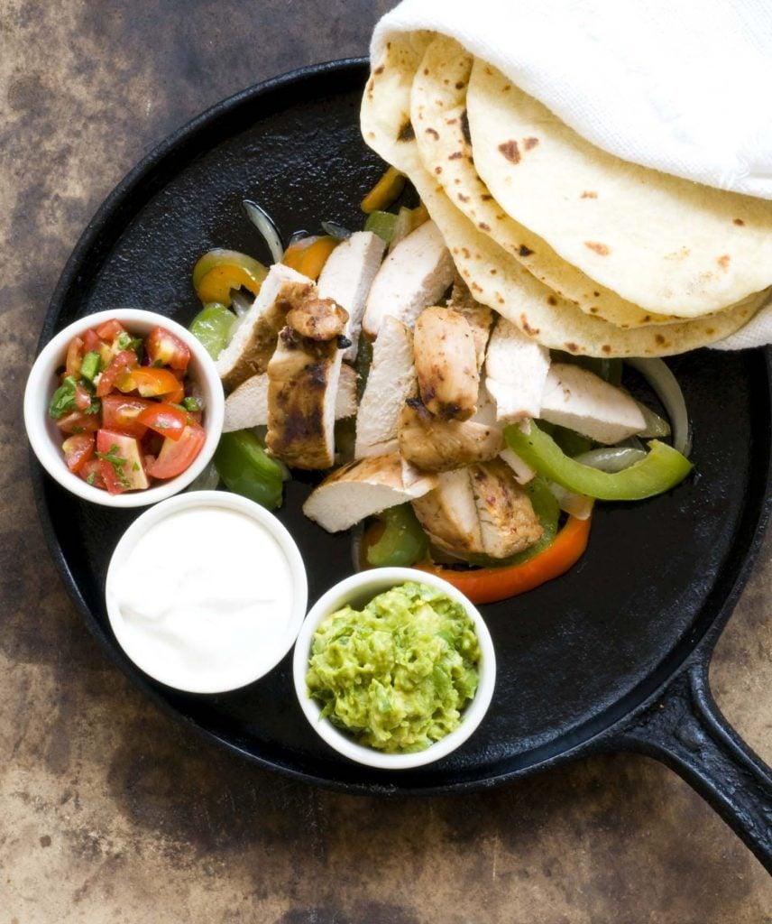 Chicken fajita fixins in a skillet.
