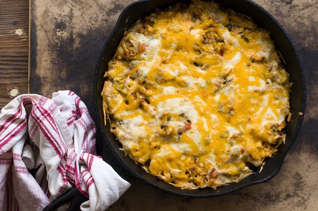 Cheesy Chicken Tortilla Casserole in a cast iron skillet.