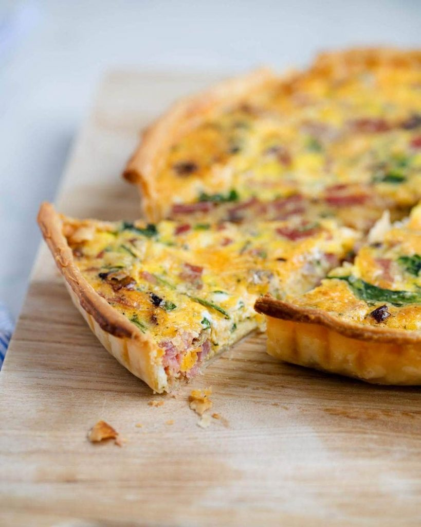 Ham & Cheese Quiche with a slice removed.