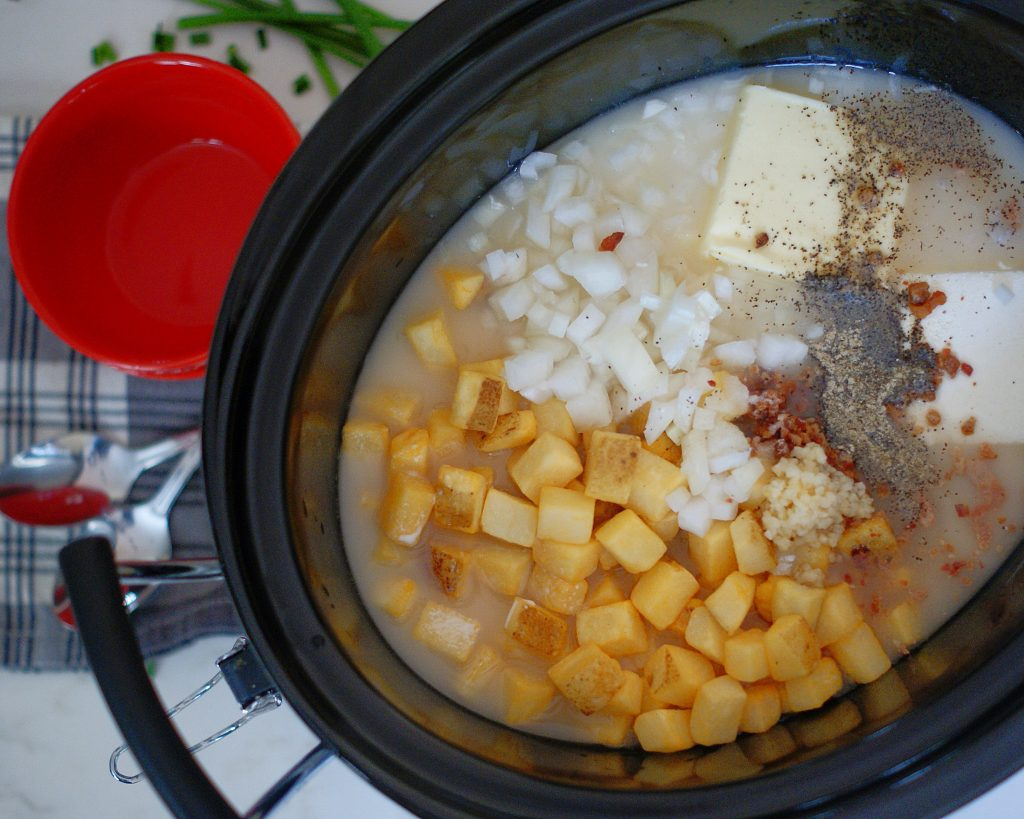 Ingredients for slow cooker potato soup in a crock pot.