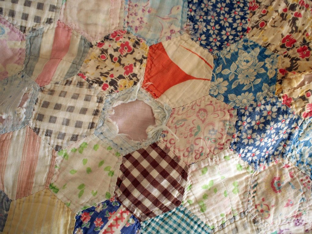 What's This About Mom Guilt?  Title pic is a worn quilt.